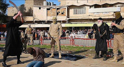 A man is forced to his knees and publicly beheaded by a sword-wielding jihadi.