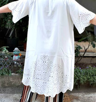 http://it.shein.com/White-Laser-Cutout-Scallop-Trim-Long-Kimono-p-308471-cat-1878.html