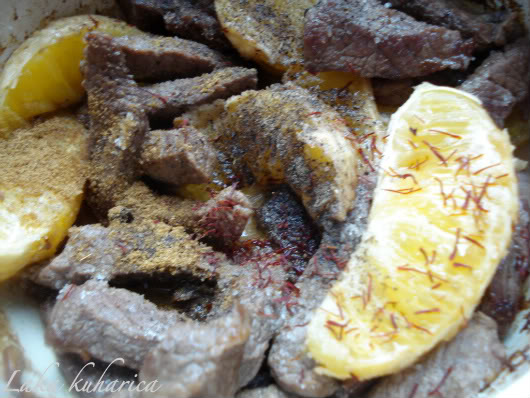 saffron, cumin, allspice, salt and pepper over beef chunks