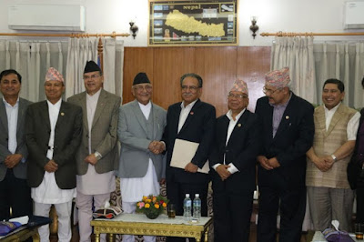 prachanda agrees to back up oli government