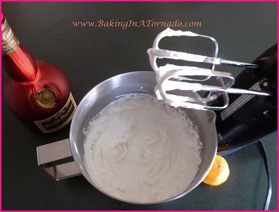 Spiked Raspberry Cocoa with Orange Whipped Cream | www.BakingInATornado.com | #recipe #cocktail