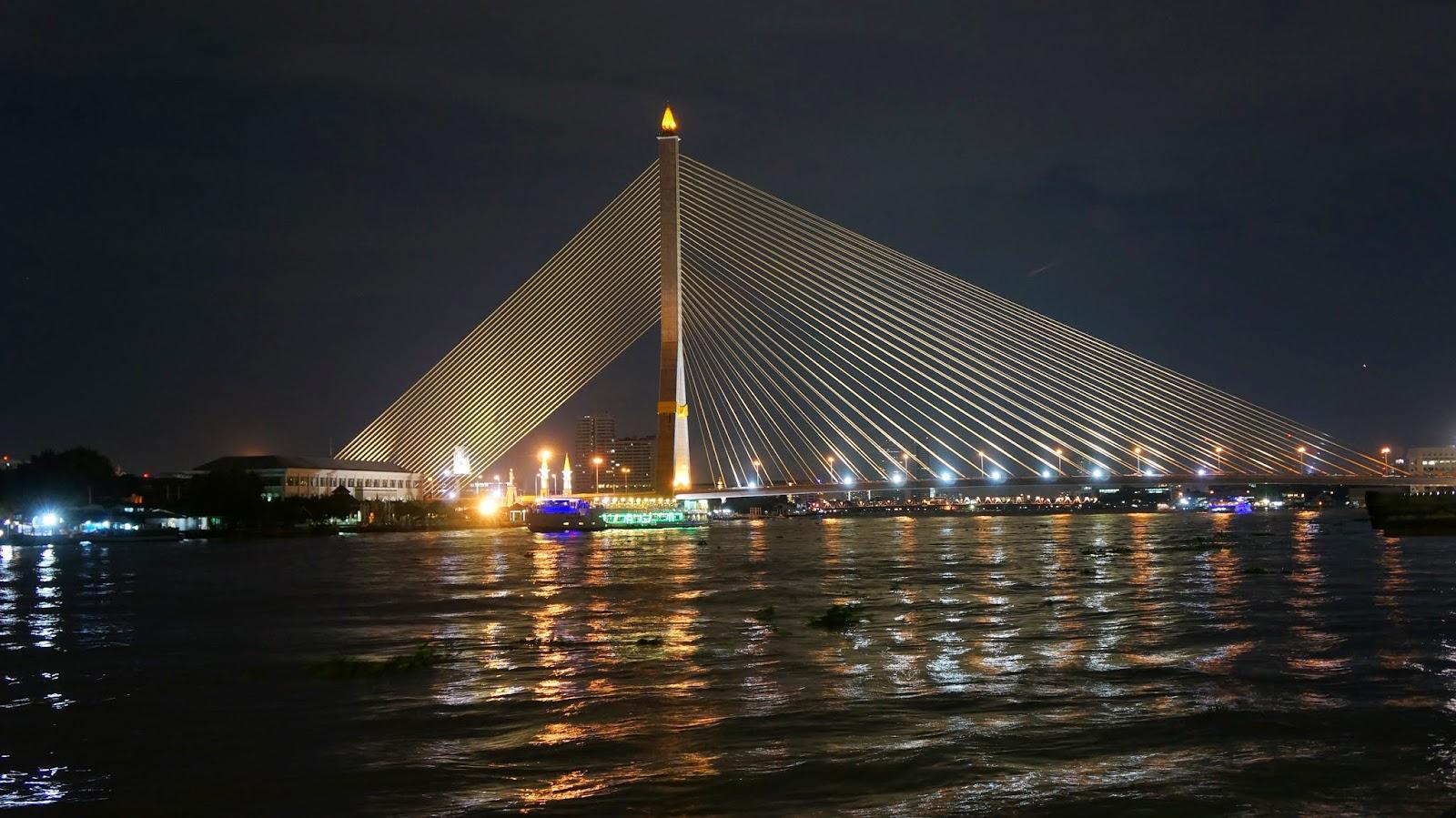 Rama VIII bridge at night, seen from Phra Athit pier
