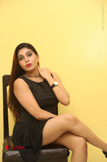 Tollywood Upcoming Actress Pooja Roshan Stills in Black Short Dress at Plus 1 Movie Trailer Launch  0277.JPG