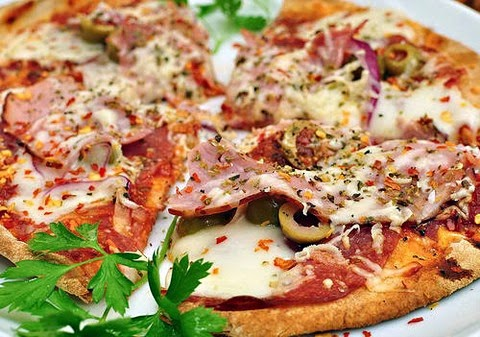 Scrumptious ham and salami pizza