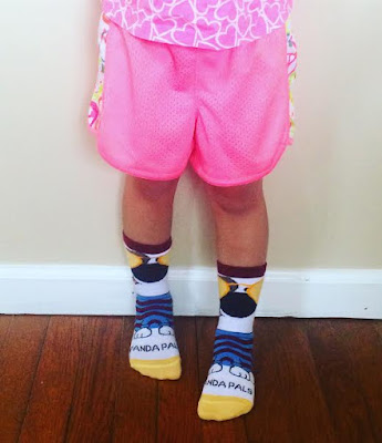 child wearing panda pal socks from sock panda