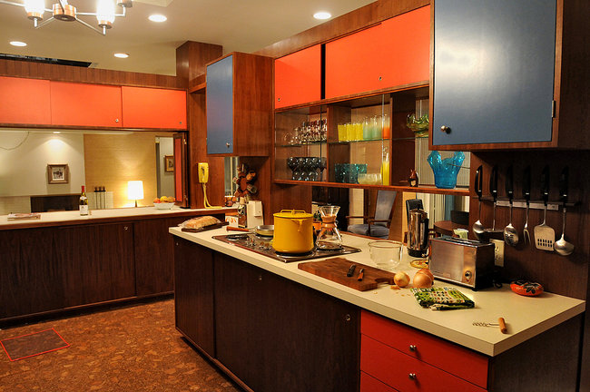 This 60s style kitchen from the set of Mad Men features colored cabinets and wood elements.