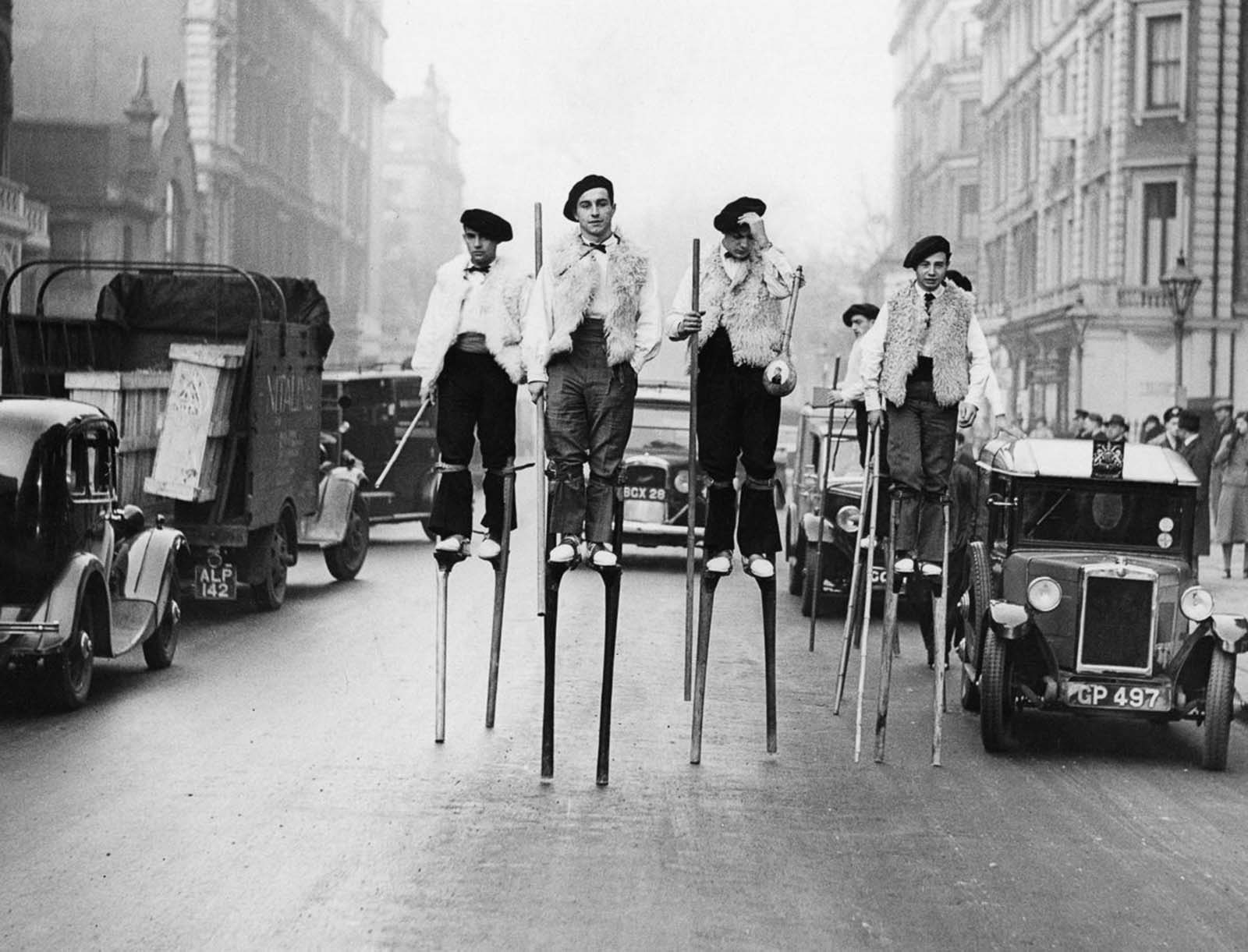 Stilt dancers from Landes walk through London on their way to a performance at the Albert Hall. 1937.