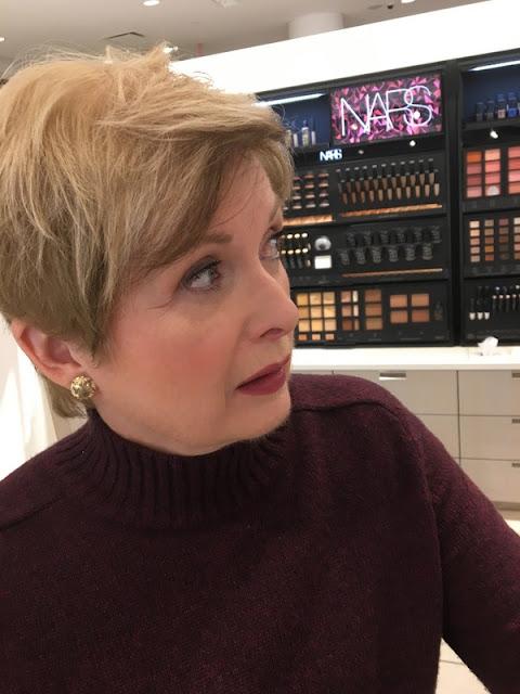 profile of woman in burgundy sweater,wearing dark lipstick