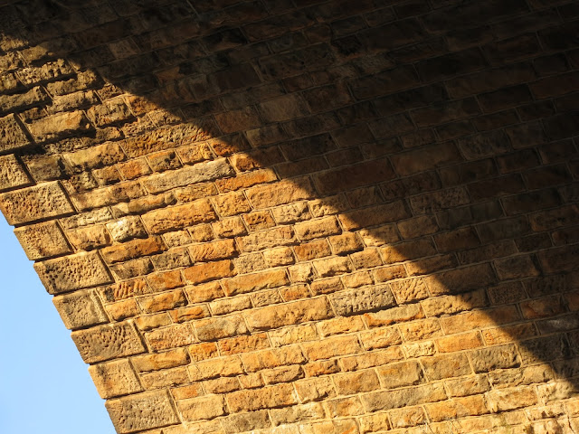 Part of underside of brick railway arch with semi-shadow