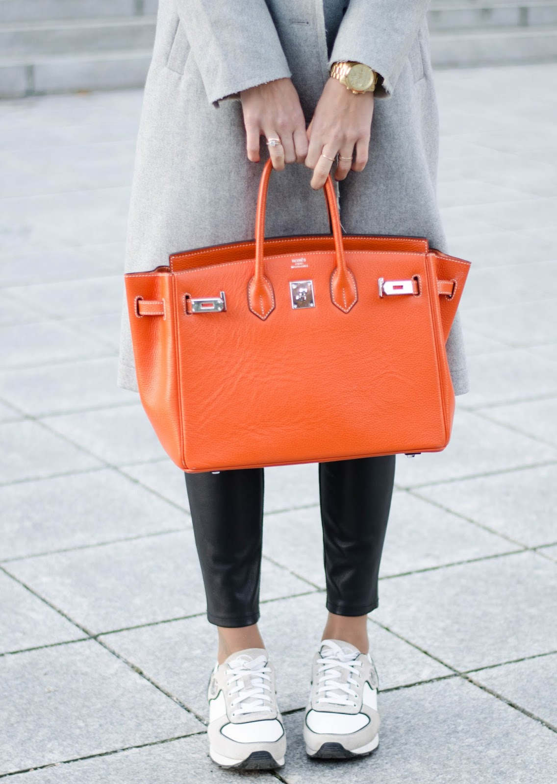 kristjaana mere orange hermes birkin bag leather pants white sneakers winter style
