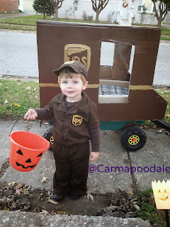 Boy in Halloween outfit of UPS driver