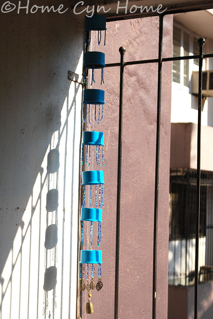 Add some boho chic vibe to your balcony or patio with this cute DIY project, all you'll need is a few beads, tin cans and a whole lot of patience