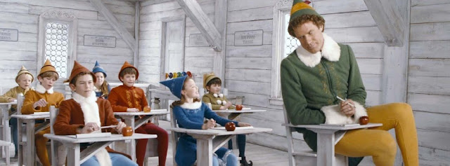 Scene from the elf movie of the big elf with the little elves