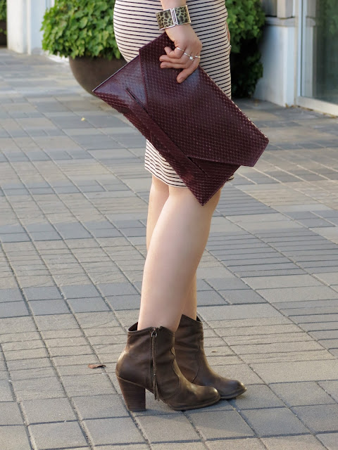 striped pencil skirt, western-inspired booties, faux-snake clutch