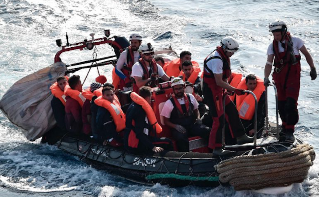 '1,000 migrants in boats off Libya' as Italy tells rescue ships to stop