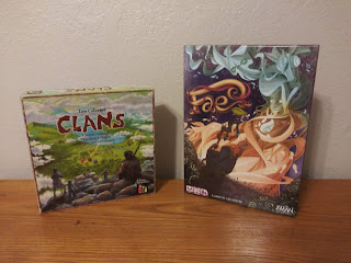 The boxes for Clans (artwork showing some prehistoric people on a hill looking down into a valley with several huts in various colours) and Fae (artwork showing a cloaked figure with a primitive staff holding his arm up towards a faerie creature).