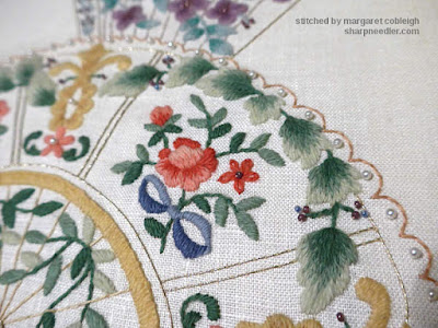 Close-up of thread painted leaves on vintage commercial crewel kit