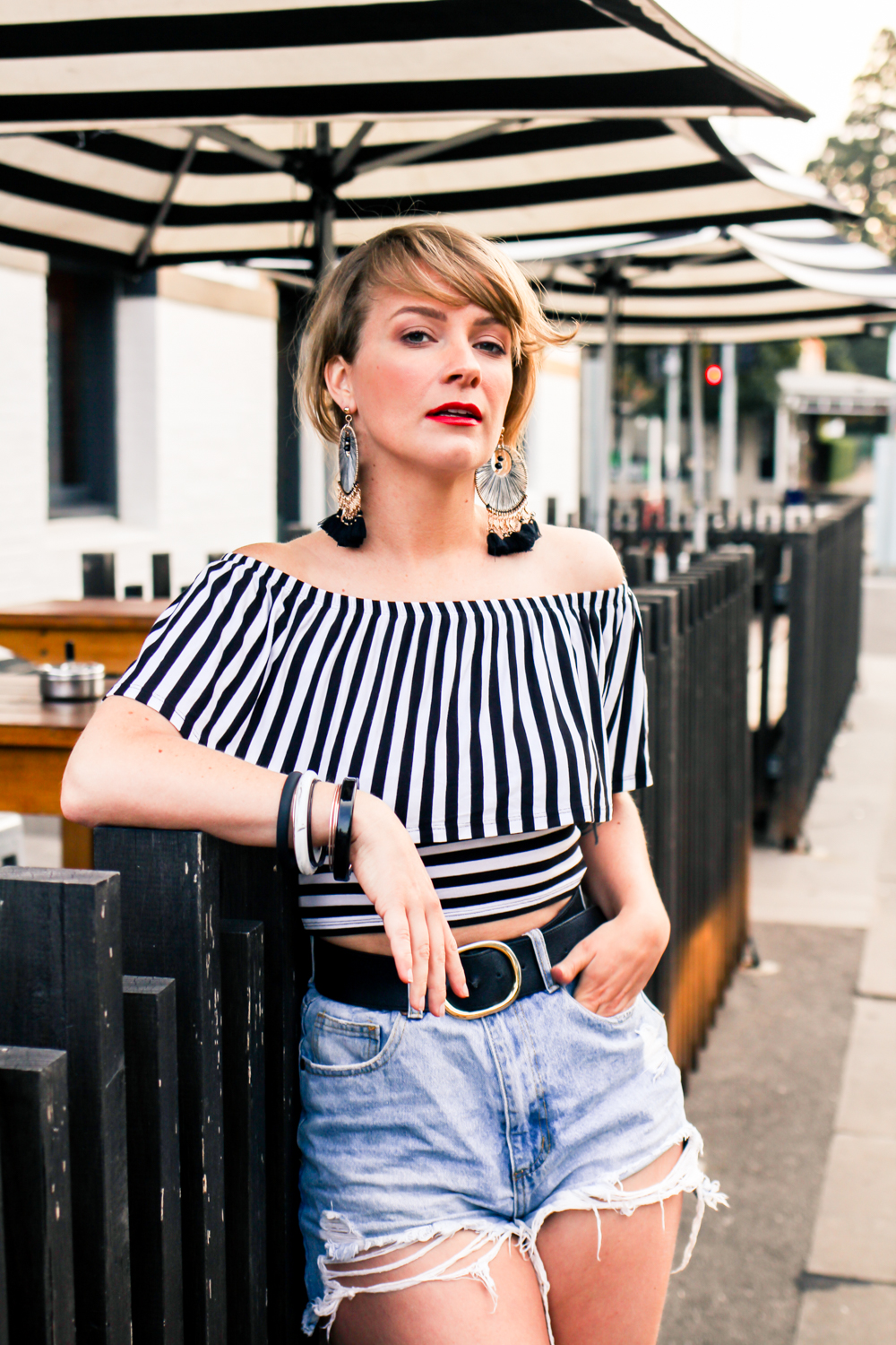 Liana of @findingfemme wears black and white striped top and statement earrings in Ballarat