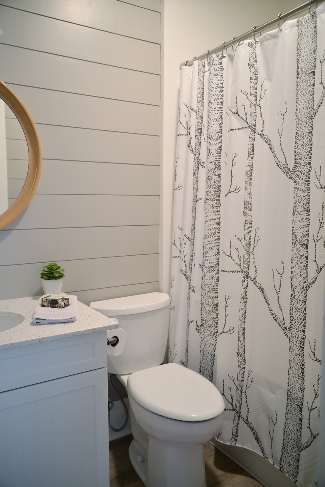 grey painted shiplap in the bathroom, woods shower curtain | Ramblingrenovators.ca