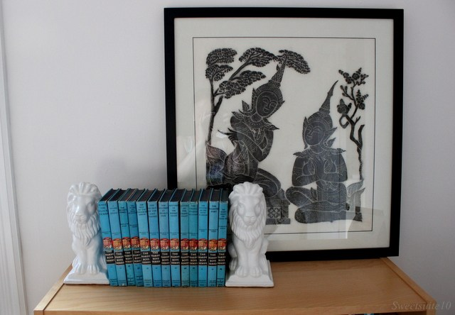 Bookcase top with temple rubbing and books