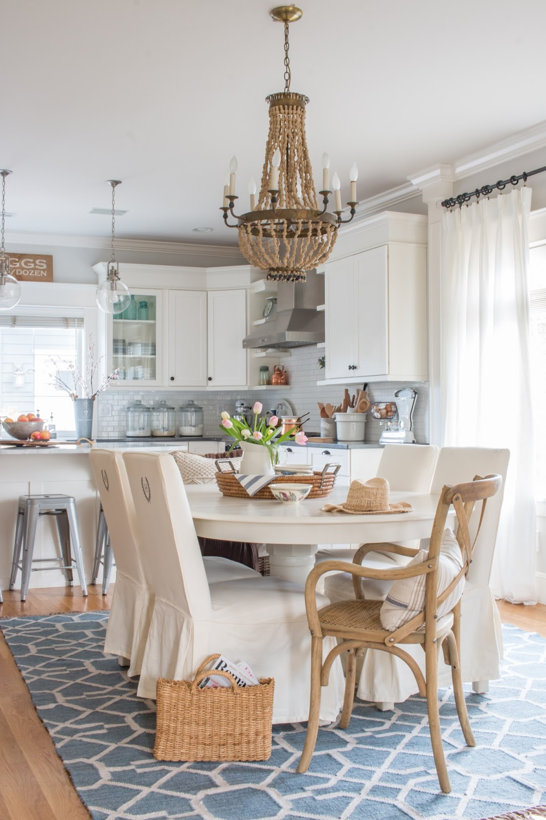 white table and cabinets in a farmhouse style kitchen