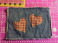 http://hangryfork.com/sewing-projects/reverse-applique-upcycled-denim-potholder/