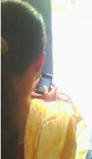 A Internet addicted woman busy with her mobile device