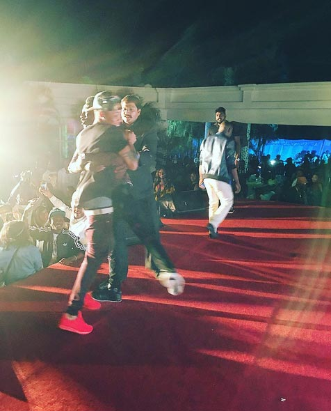 Fans run unto stage to hug Tekno during his Indian show