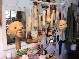 photo of sculpted and painted puppet body parts made by Corina Duyn