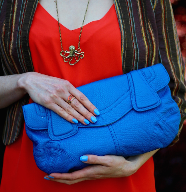 Fake Fabulous | Bright orange top, cropped brown jacket, bright blue clutch and octopus necklace.
