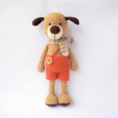 Amigurumi dog with short pants and scarf