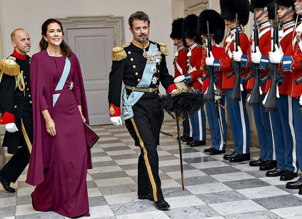 Crown Princess Mary in a fuchsia dress and cape by Danish designer Lasse Spangenberg