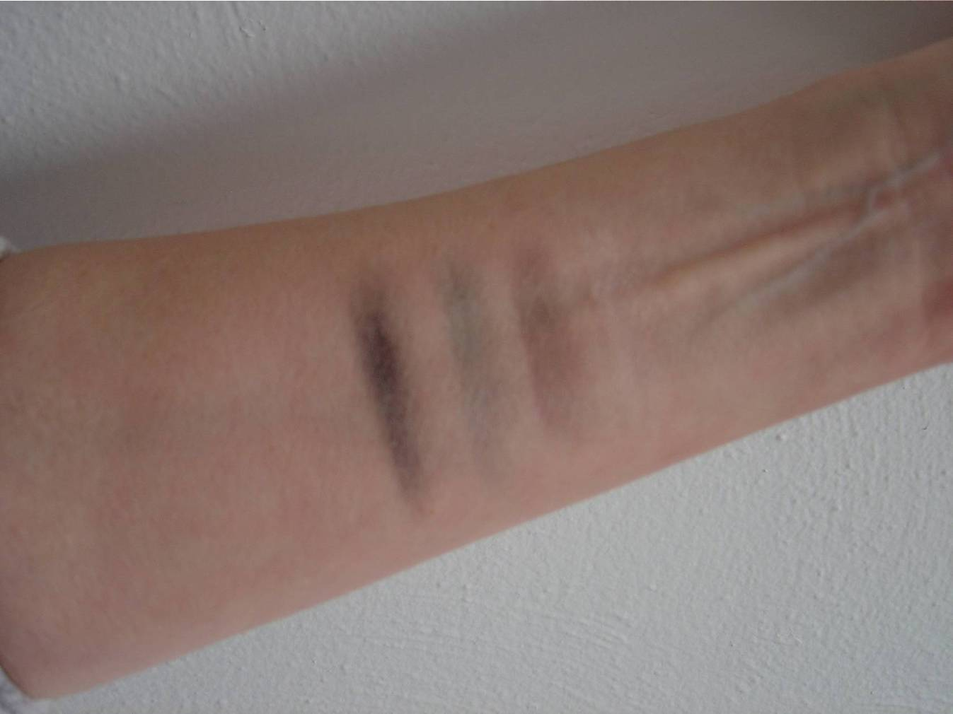 Nuance Cosmetics swatches of Smoky Eye Quad