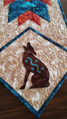 http://www.craftsy.com/pattern/quilting/home-decor/coyote-applique-template/175021