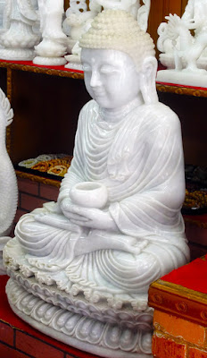 sitting white jade Buddha price about $ 25 k