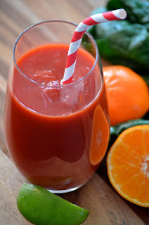 tranquilo paper straw in a glass of juice with an orange