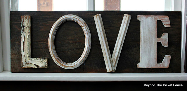 use salvaged wood to make a farmhouse sign