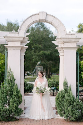 bride under arch pose