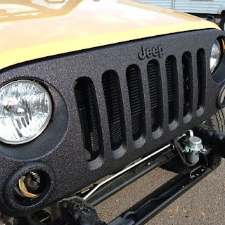 Front of Jeep painted with bedliner