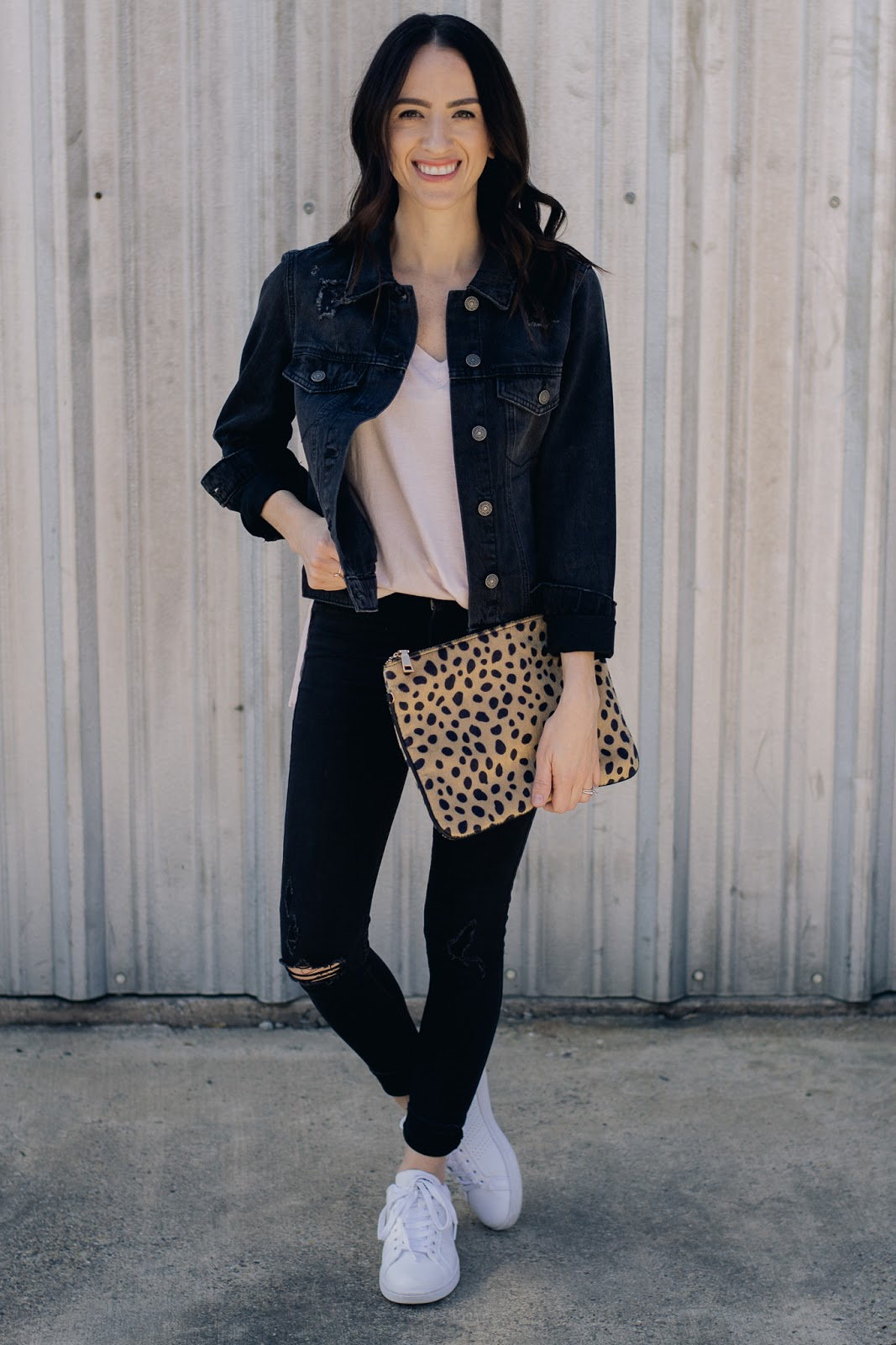 Casual style in basic tee and black distressed denim jacket with leopard clutch