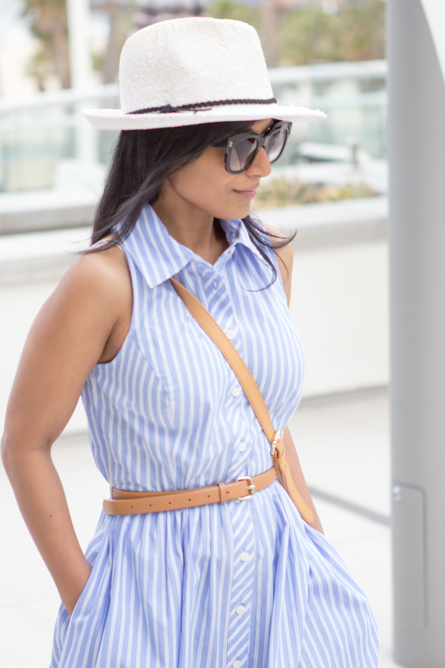 vacation wear, holiday dressing, poolside with cocktails, relaxed dressing, chic dress, belted dress, shirtdress, panama hat, express runway, pearl earrings, stella mccartney, square sunglasses, relaxing by the poo