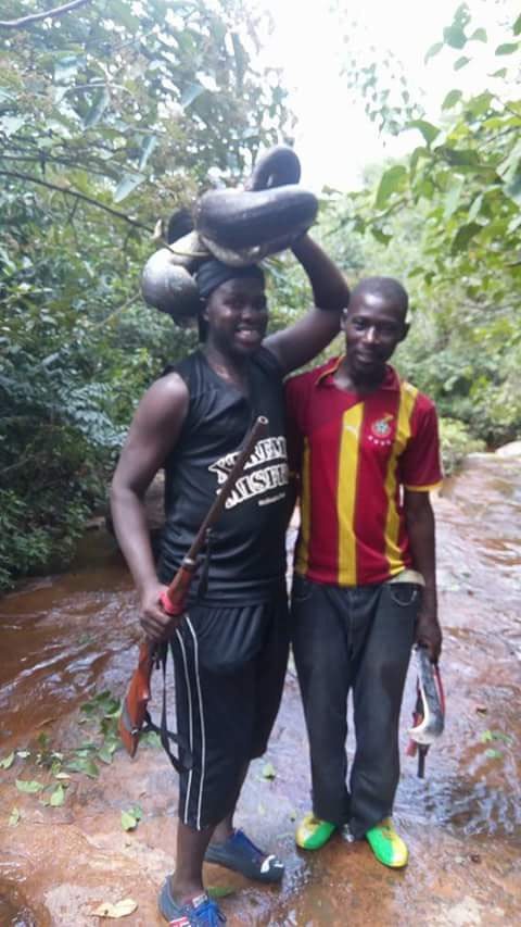 Young men extremely happy after hunting down python