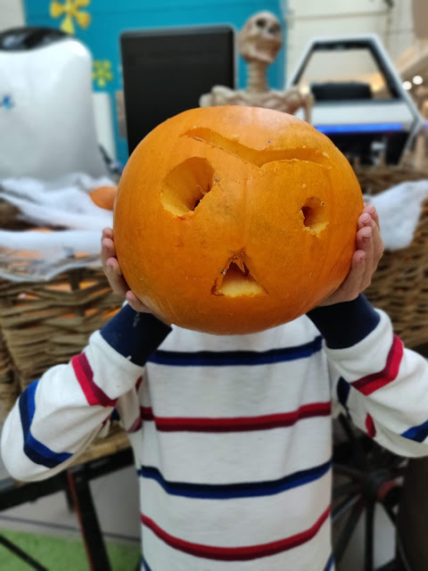 child with pumpkin head