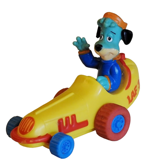 Huckleberry Hound at the wheel of a plastic race car.