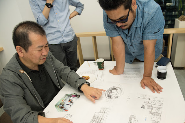 Suzuki displaying Shenmue III document