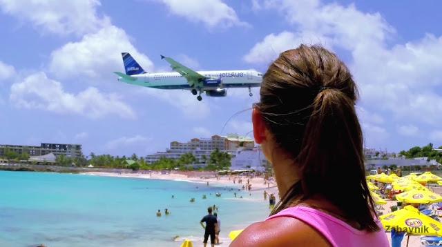 Sint Maarten airport landing & Girls top blown away on ...