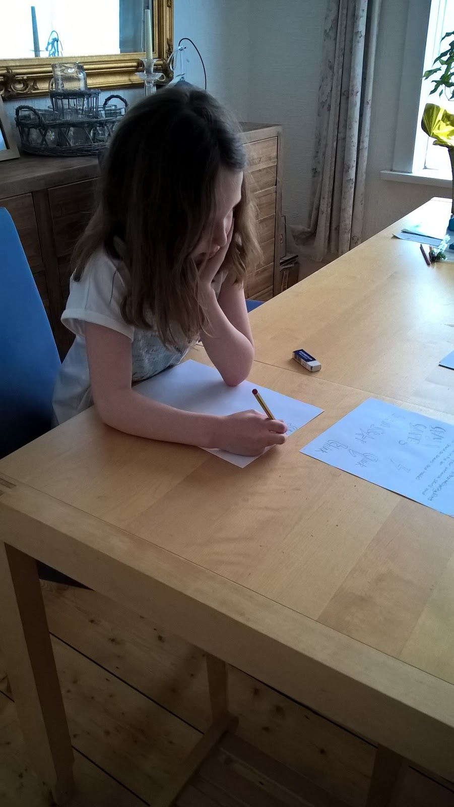 Caitlin designing her poster for the Accident Advice Helpline competition - motherdistracted.co.uk