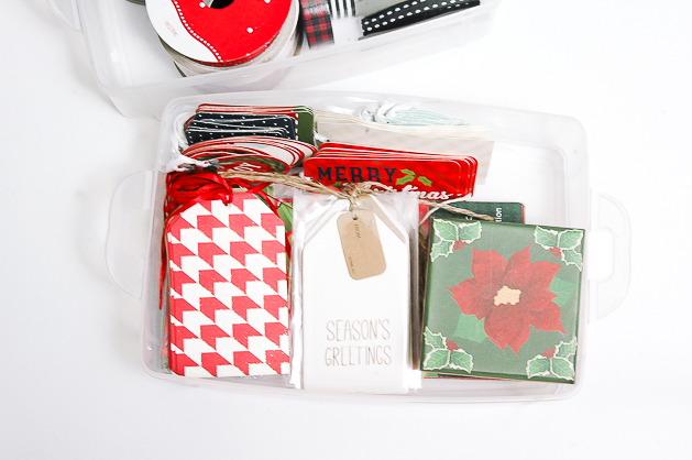 organizing holiday tags in a snapware container