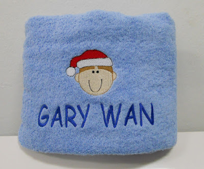 Embroidery design and name on blue bath towel