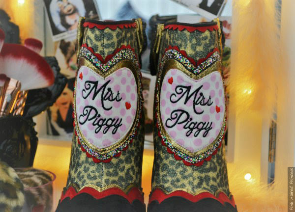 close up of applique and embroidered heart on Miss Piggy ankle boots